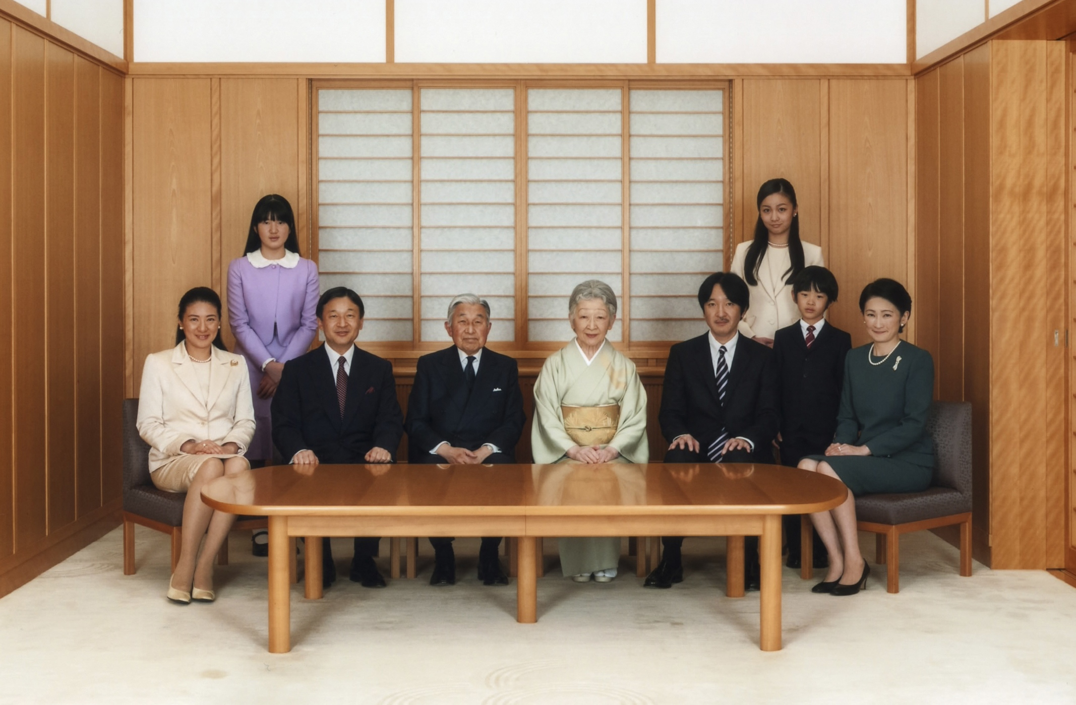 Handout picture shows Japan's Emperor Akihito and Empress Michiko posing with their family members during a family photo session for the new year at the Imperial Palace in Tokyo