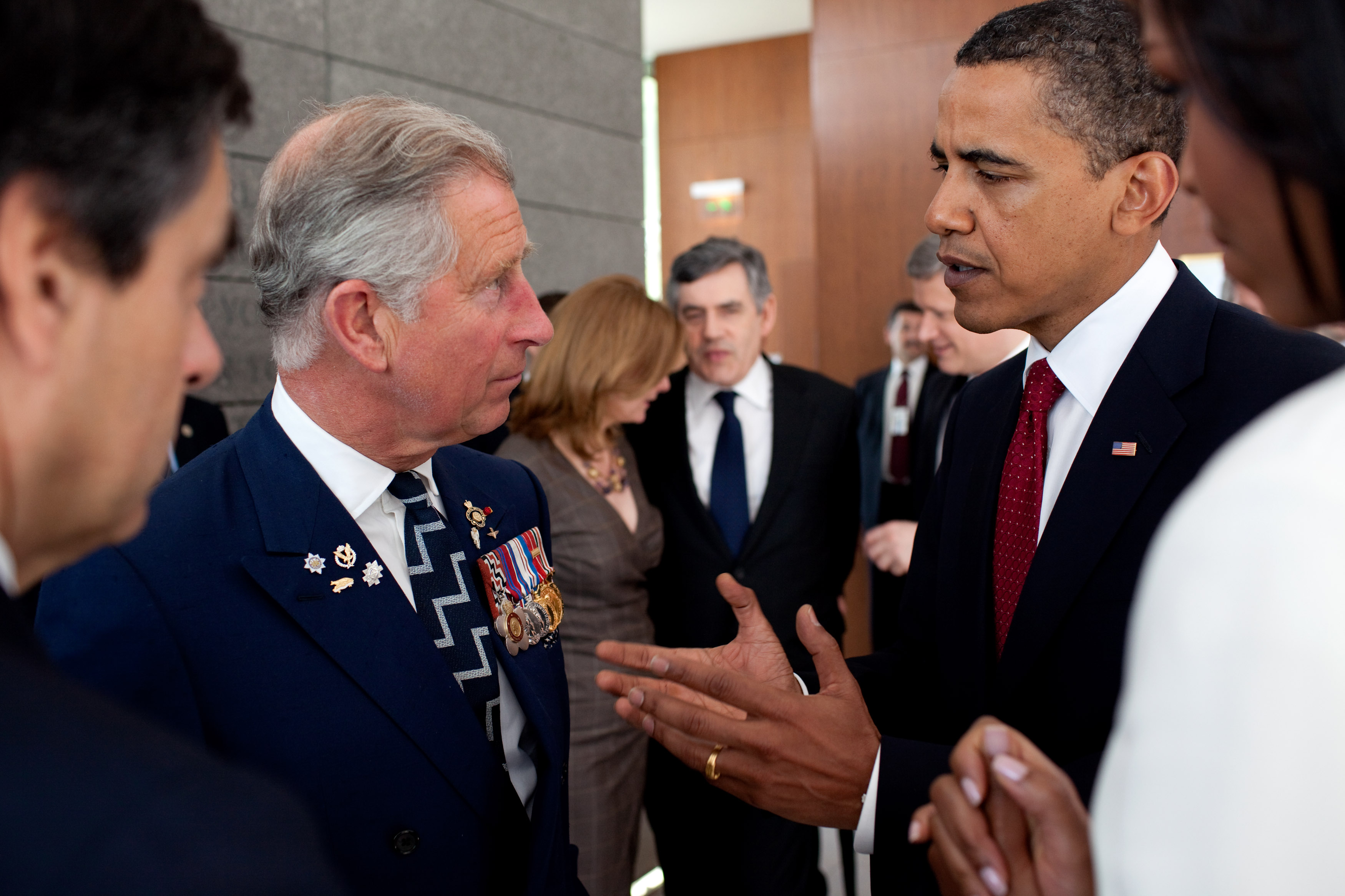 0519-0908-3119-5100_president_barack_obama_talking_with_prince_charles_at_the_normandy_cemetery_colleville_sur_mer_france_o
